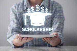 Business girl holding graduation cap. Scholarship